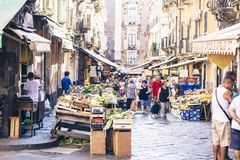 Catania, Sicily, Italy – august 16, 2018: market square with people who buying vegetables and fruits royalty free stock photography