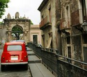 Catania street scene. Street scene in Catania city with car in foreground, Sicily, Italy royalty free stock image