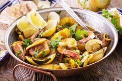 Cataplana. Seafood cataplana as closeup on a traditional pot stock photography