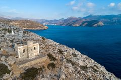 Catapola Lighthouse in Vathy of Amorgos was built in 1882. It is one of the oldest lighthouses. Of the Greece stock image