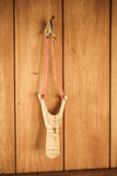 Catapult hang over wall from thailand Royalty Free Stock Photo