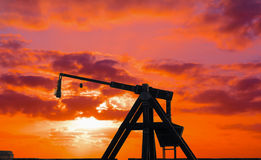 Catapult silhouette under a red sunset Stock Photography