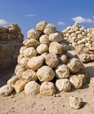 Catapult Stones. Heap of catapult stones in Apollonia National Park - Israel Stock Photo