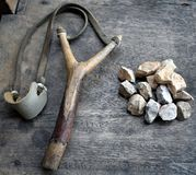 Catapult with stones on wood background stock image