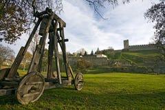 Catapult under city wall Royalty Free Stock Photo