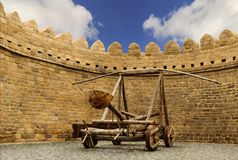 Catapult wooden Turkish Mancinik in city wall. Icheri Sheher (Old Town) of Baku Azerbaijan Royalty Free Stock Photo