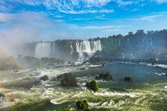Cataratas waterfalls view from the bottom with some rocks. Foz do Iguacu, Brazil - july 9, 2016: Cataratas waterfalls view from the bottom with some rocks stock photo