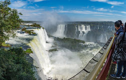 Cataratas waterfalls view from the top with some rocks. Foz do Iguacu, Brazil - july 9, 2016: Cataratas waterfalls view from the top with some rocks covered by royalty free stock photos