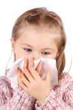 Catarrh. Four year old  girl blow one's nose Stock Image