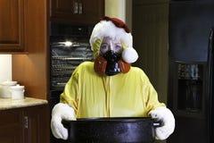 Catastrophe de dîner de Noël avec le costume de HazMat Photo libre de droits