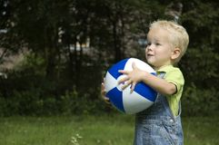 Catch the ball. Little boy has caught the ball royalty free stock photography