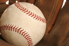 Catch the ball. Catcher's mitt with a baseball Stock Images