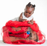 Catch the blue ball. A 8 month old baby dressed to explore Christmas Royalty Free Stock Images