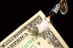 Catch of the Day. Dollar Bill on a Fish Hook Royalty Free Stock Photos