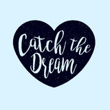 Catch the dream lettering in the heart silhouette rough shape, grunge textured print design Royalty Free Stock Photography