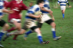 Catch me If You Can. English Rugby Action, a hand reaches out in desperation as forward sprints for the line stock photography