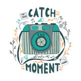 Catch the moment.  Motivational quote. Hand drawn vintage illustration with hand lettering, and a camera. This illustration can be used as a print on t-shirts Stock Image