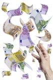 Catch money. This image shows a hand trying to take money that is flying through the air Royalty Free Stock Image