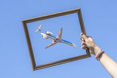 Catch a plane in a frame Stock Images
