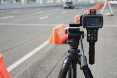 Catch speeding drivers. With a radar gun Royalty Free Stock Photos