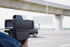 Catch speeding drivers. With a radar gun Stock Photography