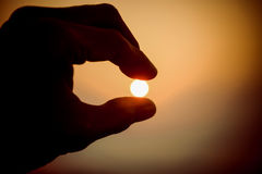 Catch the Sun. Finger catching the sun in the morrning stock images