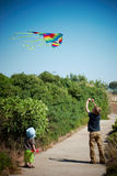 Boys Flying a Kite Stock Images