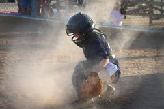Catcher. A young boy playing catcher at a baseball game Royalty Free Stock Photography