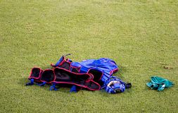 Catcher Equipment. Cather's protective equipment lays on the field Royalty Free Stock Photos