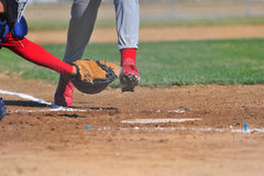 Catcher reaching for a runner Stock Images