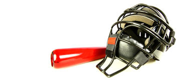 Catchers Helmet and bat Stock Images