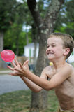 Catching The Balloon Royalty Free Stock Image