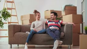 Catching a break while moving house. Young couple catching a break while moving house stock video