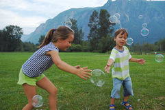 Catching bubbles Stock Photography
