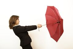 Catching business wind. Business woman in suit holding red umbrella Stock Photo