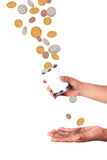 Catching falling dollars and cents stock photography