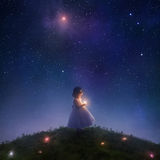 Catching falling stars. A little girl catches stars falling from the sky Stock Images