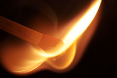 Catching fire III. Wooden match catching fire on black background Royalty Free Stock Photos