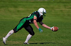 Catching the Football Stock Photography