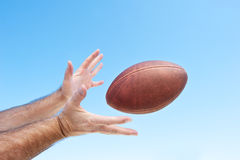 Catching a football Royalty Free Stock Photo