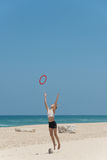 Catching frisbee. Young girl on a beach catching frisbee Royalty Free Stock Photography