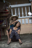 Catching head lice, it's also work. Women from Hoi An, the woman cleans the head, looking for lice in the hair Stock Photos