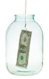 Catching the last dollar from glass jar Stock Photography