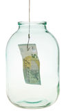 Catching the last euro banknote from glass jar Royalty Free Stock Photography