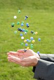 Catching marbles Royalty Free Stock Photo
