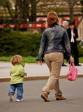 Catching Mom. A child and mother on the street Royalty Free Stock Images