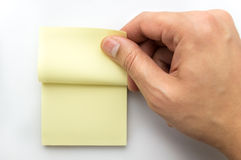 Catching a note. Hand catching a note from post it stock image