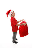 Catching objects in santa sack Stock Photos