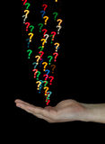 Catching question marks made of light Royalty Free Stock Images