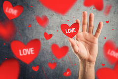 Catching red Valentines hearts with word LOVE printed. Royalty Free Stock Photo